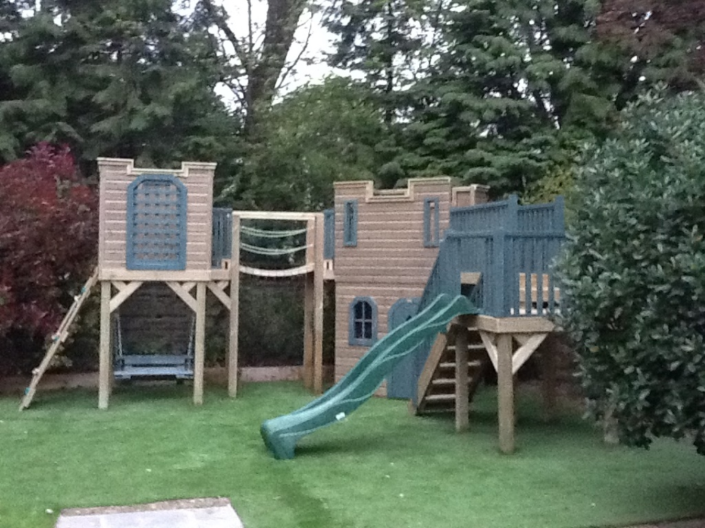 Play castle with activities and lookout tower castles for Childrens playhouse with slide and swing