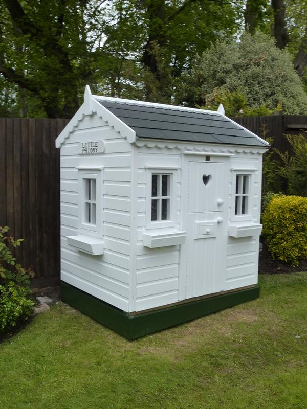 Wooden wendy house with slate roof