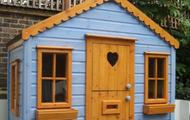 Cottage playhouse with scalloped facia