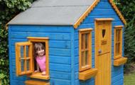 Children looking out of open playhouse window