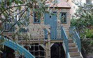 Staircase access to treehouse; scramble net and slide