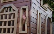 Waving from the play castle window