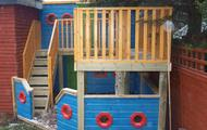 Port holes in playhouse boat