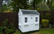 Wendy house with windows boxes