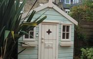 Playhouse with stable door, window boxes and doorbell
