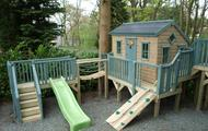 Treehouse with slide, wobble bridge and climbing wall