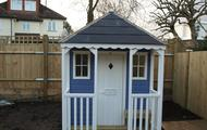 Playhouse and veranda with door and windows