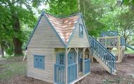 Playhouse with cedar roof shingles and external staircase