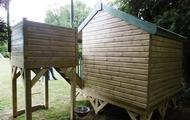 Side of wooden playhouse with tower