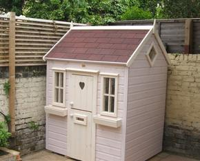 Small patio playhouse with felt shingles on roof