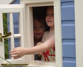 Children looking out of playhouse window