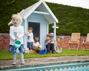 Children playing in beach hut